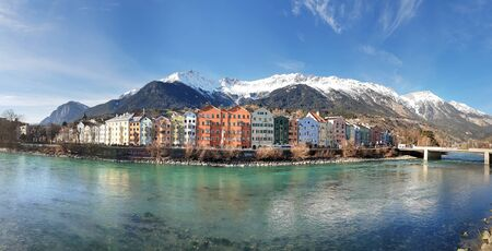 Panoramic view of Innsbruck with colourful houses along Inn river