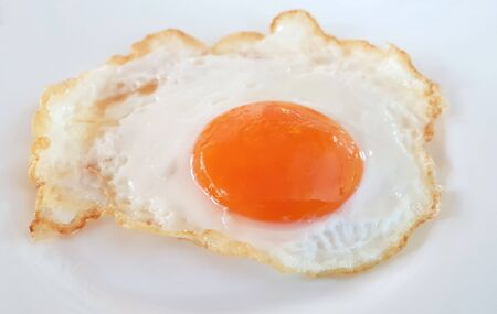 Fried egg on a white plate  Stockfoto
