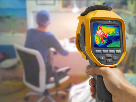 Recording whit Thermal camera, Young Girl using laptop on at home Stockfoto