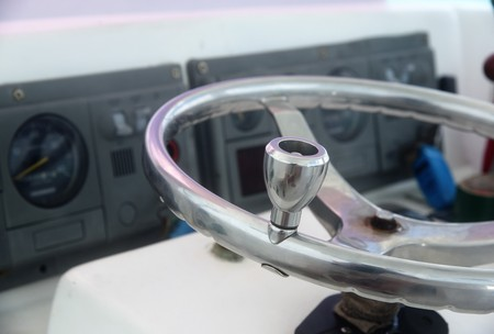 Sterring wheel that is patched up with tape in a tourist boat in Belize is a cause for concern for safety on water