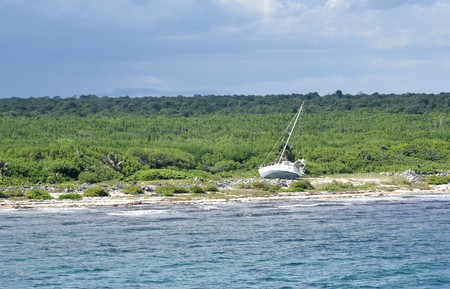 Abandoned Sail Boat on Mexican Costa Maya depicts the lost dreams, goals that are given up