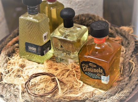 September 2018, Costa Maya - Famous Mexican Tequilla Brands are displayed on wooden barrel and ropes
