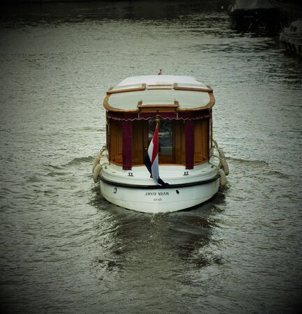 Cute Little Dutch Boat is a symbol of Amsterdam Editorial