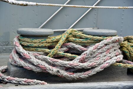 Faded colors of nautical knots in boat bollards