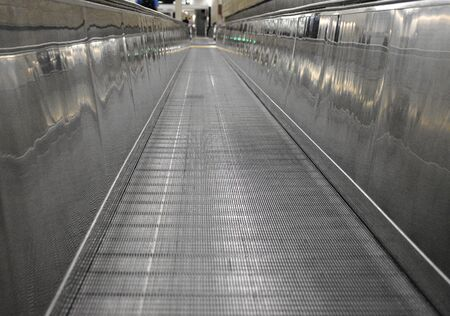 Long and Empty Walkway inside an aiport while connecting flights