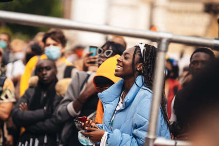 London / UK - 06/27/2020: Young girl smilling At Black Lives Matter Protest