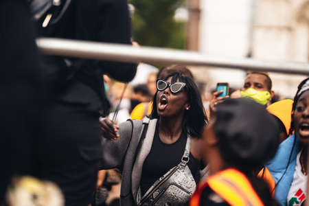 London / UK - 06/27/2020: Lady wearing glasses chaunting At Black Lives Matter Protest