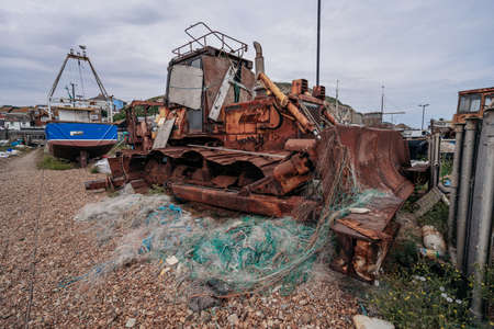 Hastings Port, East Sussex / UK -  2020.08.08: Bulldozers at Hastings fishing boats on the beach at Rock-a-Nore Reklamní fotografie