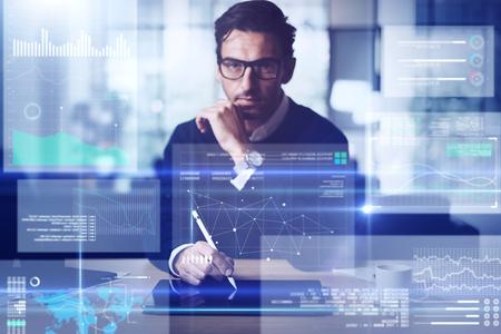 Businessman analysing the data on futuristic screen