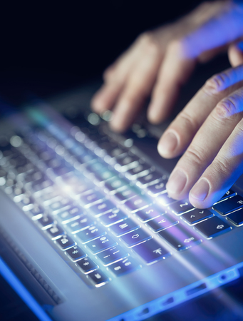 Male hands using laptop