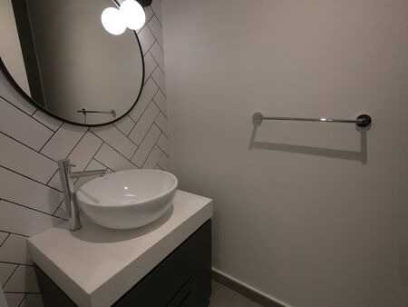 Guest toilet with wash basin. Toilet for guest interior in luxury house. Stockfoto