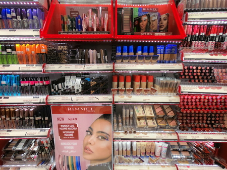 Make up products displayed for sale at a supermarket. Cosmetic Products For Sale In Fashion Beauty Shop Display.