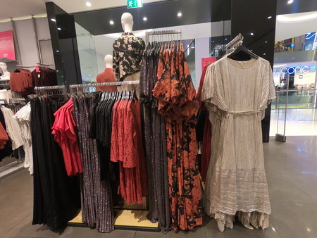 Dubai UAE - May 2019: Man, Woman Mannequin displaying fancy clothes for sale. Womens Clothes displayed for sale in clothing store.