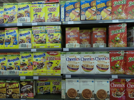 Dubai UAE - May 2019: Golden Nuggets, Cheerios,smacks, Nesquik, Coco pops, kids cereal breakfast food displayed for sale. Editorial