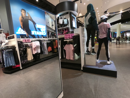 Dubai UAE May 2019 - Sports Clothes displayed for sale in a mall in Dubai. Interior of a Sports Wear Shop