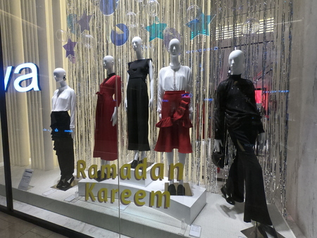 Dubai UAE - May 2019: Clothes on mannequin displayed for sale in a mall in Dubai.