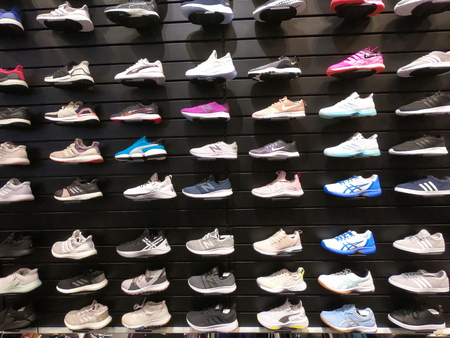 Dubai UAE May 2019 - Big collection of different sport shoes. Assorted sports choes for sale - Nike, Adidas and Puma.