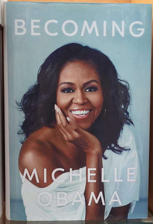 Becoming book written by Michelle Obama at the bookstore. books by Michelle Obama displayed on the shelves of a book shop. Library - Kochi, India: January 2020 Editorial
