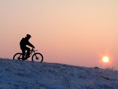 mountain biker - snowrider Stock Photo