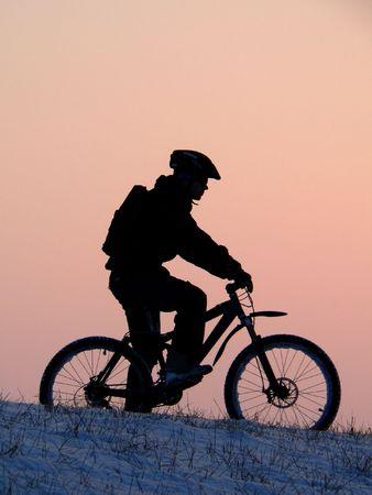 mountain biker silhouette in winter sunset Stock Photo - 752789