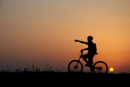 mountain biker silhouette in sunrise Stock Photo - 1304923