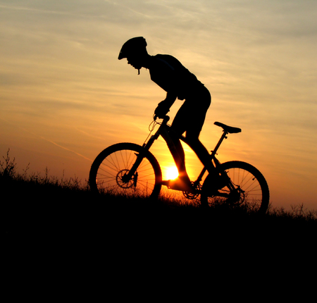 mountain biker silhouette in sunrise stock photo picture and royalty free image image 1600444