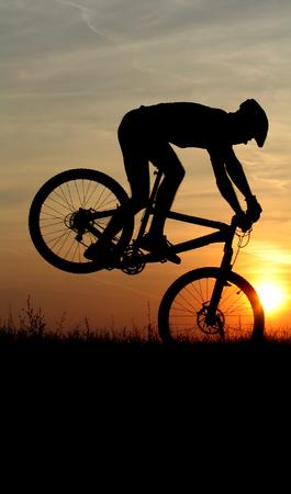 mountain biker silhouette in sunrise Stock Photo - 1630827