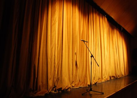 elegant theater stage, orange curtain with microphone