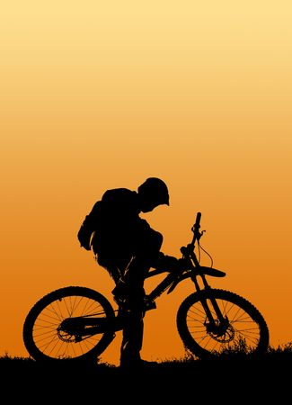 mountain biker silhouette in orange sunrise Stock Photo - 5431451