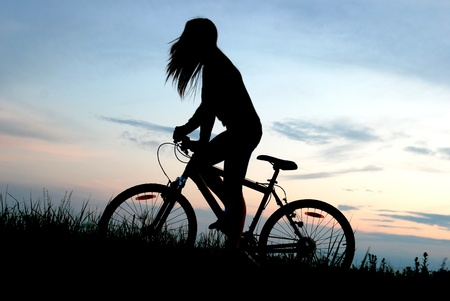 mountain biker girl in sunrise