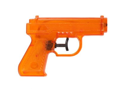 Orange plastic water pistol isolated on a white background photo
