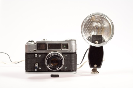 old vintage rangefinder camera with isolated on white background photo