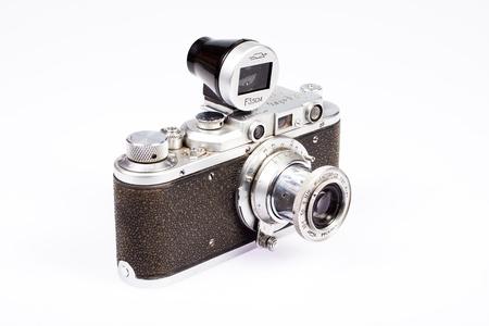 viewfinder vintage: old vintage rangefinder camera with additional viewfinder isolated on white background