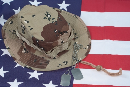 US Flag with Camouflage Combat Hat and Dog Tags photo