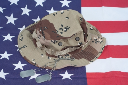 US stars and stripes with Camouflage Combat Hat and Dog Tags photo