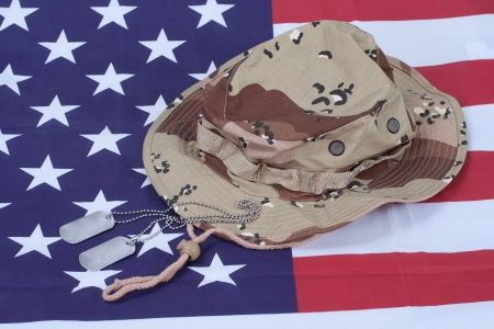 US stars and stripes with Camouflage Hat and Dog Tags photo