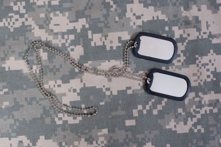 us army camouflaged uniform with blank dog tags photo