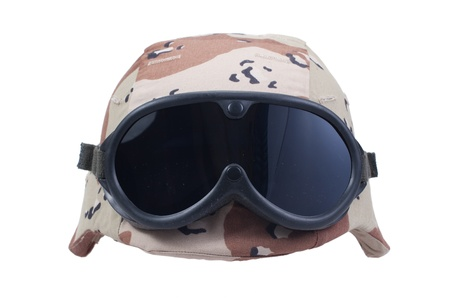 kevlar: us army kevlar helmet with a desert camouflage cover and protective goggles