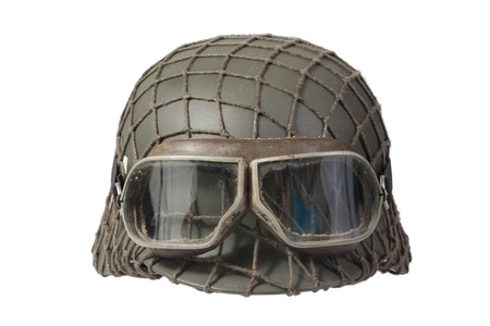 camouflaged nazi german helmet with protective goggles Standard-Bild