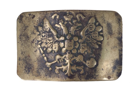 Old vintage buckle from Russian Empire Army uniform isolated on a white background