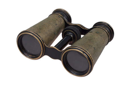 Vintage old  bronze binoculars isolated on a white background photo