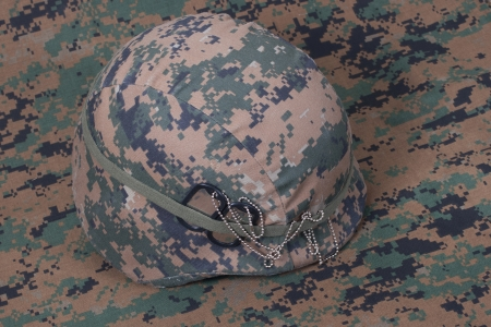 kevlar: kevlar helmet with dog tags on camouflage cover