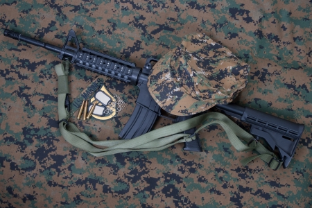 sergeant: M4 carbine and blank dog tags on us marines camouflage uniform