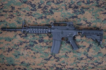 M4 carbine on us marines camouflage uniform photo
