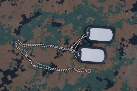 camouflaged: us army camouflaged uniform with blank dog tags