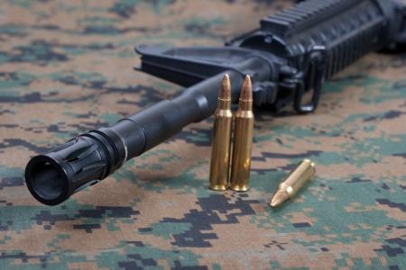 carbine: m4 carbine on camouflage uniform