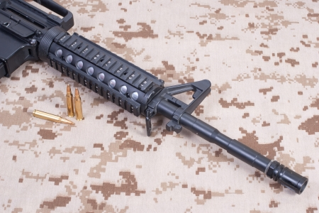 m4 carbine on camouflage uniform