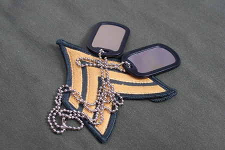 sergeant: us army uniform period with blank dog tags and sergeant rank patch