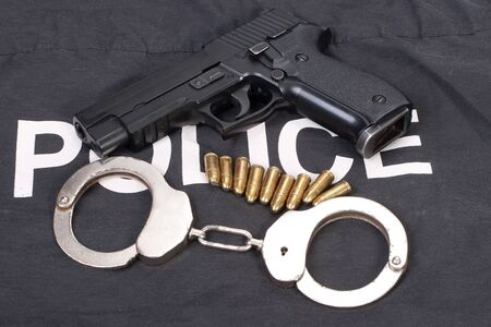 glock: security concept with gun ammo and handcuffs