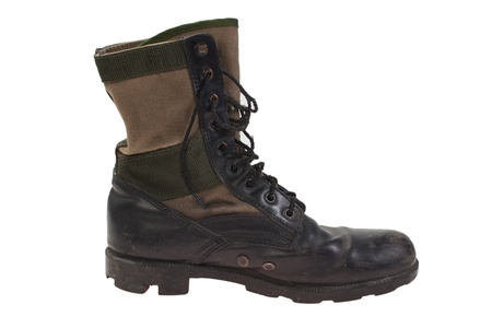 combat boots: old used combat boots vietnam war period isolated
